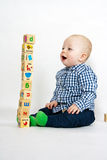 Playing with wooden blocks Royalty Free Stock Photos