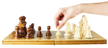 Playing wooden chess on chess board Royalty Free Stock Images