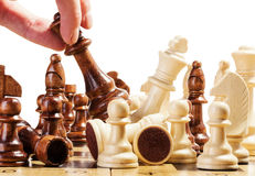Playing wooden chess on chess board Royalty Free Stock Photos