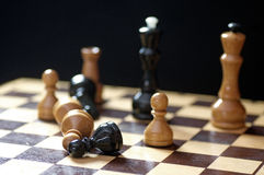 Playing wooden chess pieces game over Royalty Free Stock Photography
