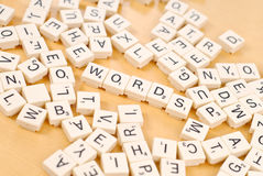 Playing Word Games. With Letter Tiles Stock Photo
