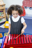 Playing Xylophone at Nursery Stock Photography