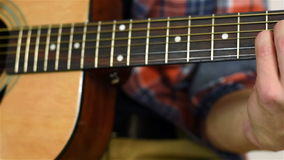 Playing At Yellow Acoustic Guitar stock video footage