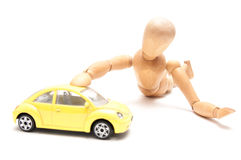 Playing with a yellow car Royalty Free Stock Photography