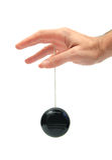 Playing yo-yo. Closeup of a hand playing yo-yo over white Stock Photo