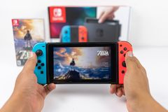 Playing Zelda breath of the wild in Nintendo Switch Stock Photo