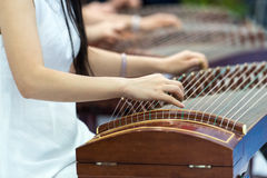Playing Zither. People are playing Chinese traditional Zither Royalty Free Stock Photography
