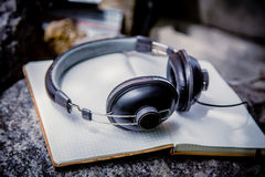 Playlist, notebook Headphones Royalty Free Stock Image