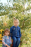 Playmates. Portrait of two lovely little girls Royalty Free Stock Images