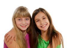 Playmates. Two Happy Playmates Smiling and Hugging isolated on white background Royalty Free Stock Images