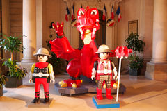Playmobil Exposition City Hall France. Big Playmobil figures including a dragon are displayed in the entrance of the town hall of Levallois-Perret (Hauts-de Stock Photo