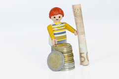 Playmobil figure with money Stock Images