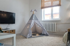 Playroom for kids with Teepee royalty free stock image