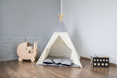 Playroom with Teepee. Light Playroom for kids with Teepee tent Royalty Free Stock Photo
