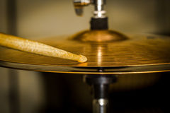 Plays a drum stick on the hi-hat or ride cymbal. Drums, percussion musical instrument, photo closeup stock photography