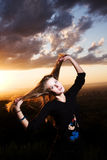 Plays with hair. The girl plays with the hair a sunset Stock Image