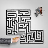 He plays his success music. Top view of businessman playing violin and drawn labyrinth on floor stock image