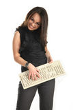 She plays the keyboard and smiles Royalty Free Stock Photos