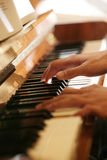Plays on piano. With motion Royalty Free Stock Images