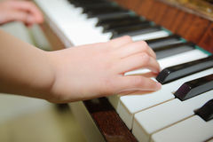 Plays the piano Stock Image