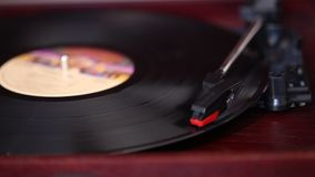 It plays a vinyl record player, a retro record player, an old music player.  stock video footage