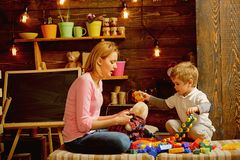 Playschool concept. Playschool kid play with mother. Playschool activities. Playschool education and child care.  stock photo