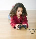 Playstation de la chica joven fotografía de archivo