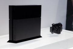 PlayStation 4 and Dualshock 4. LOS ANGELES - JUNE 11: Sony unveiling PlayStation 4 retail design for the first time at E3 2013, the Expo for video games on June Royalty Free Stock Image
