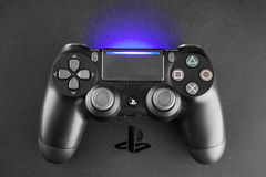 Playstation 4 gaming console. WROCLAW, POLAND - 20 MARCH, 2017: Playstation 4 Slim gaming console with Dualshock controller Royalty Free Stock Images