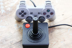 Playstation joystick with vintage joystick Royalty Free Stock Images