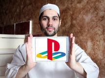 Playstation logo. Logo of playstation on samsung tablet holded by arab muslim man Stock Photos