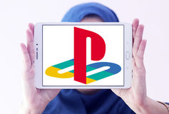 Playstation logo. Logo of playstation on samsung tablet holded by arab muslim woman Royalty Free Stock Image