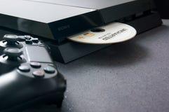 Playstation 4 na biurku Zdjęcia Royalty Free