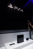 PlayStation 4 and PS4 Logo. LOS ANGELES - JUNE 11: Sony unveiling PlayStation 4 retail design for the first time at E3 2013, the Expo for video games on June 11 royalty free stock photo