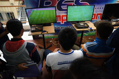 Playstation. Teenagers are following playstation competition in a mall in Karanganyar, Central Java, Indonesia Stock Photos