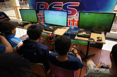 Playstation. Teenagers are following playstation competition in a mall in Karanganyar, Central Java, Indonesia Stock Photo