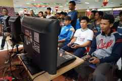 Playstation. Teenagers are following playstation competition in a mall in Karanganyar, Central Java, Indonesia Royalty Free Stock Image