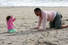 Playtime. Father and daughter playing at the beach Royalty Free Stock Photography