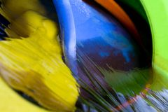Playtime Colours. An image of brightly coloured garden toys in a pool of iced over water Stock Image