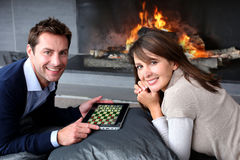 Playtime by fireplace Royalty Free Stock Photo