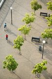 Plaza. Overhead view of a couple cycling through a plaza. Vancouver, British Columbia, Canada Stock Photography
