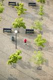 Plaza. Overhead view of a runner jogging through a plaza. Vancouver, British Columbia, Canada Royalty Free Stock Photo