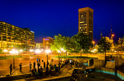 A plaza and buildings at night in Baltimore, Maryland. Royalty Free Stock Photos