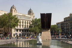 Plaza Catalunia Barcelona. A statue on a pool and the historical buildings of Plaza Catalunia, Barcelona, Spain royalty free stock photo