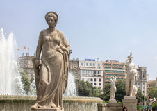 Plaza Catalunia Barcelona. Statues on a fountain and the historical buildings of Plaza Catalunia, Barcelona, Spain royalty free stock images