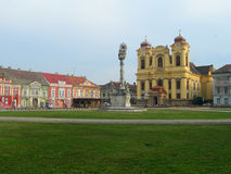 Plaza with catholic church and baroque buildings Stock Images