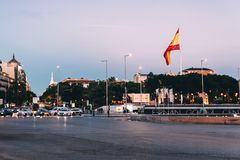 Plaza of Colon in Madrid at sunset with traffic lights and Spani. Madrid, Spain - May 1, 2017: Square of Columbus or Plaza of Colon in Madrid at sunset with stock images