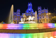 The Plaza Cybeles, palace and fountain illuminated at dusk in madrid, Spain royalty free stock photos