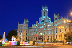 The Plaza Cybeles, palace and fountain illuminated at dusk in madrid, Spain stock photo