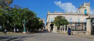 Plaza de Armas in central Havana. Havana, Cuba - March 12, 2018: Plaza de Armas with old spanish buildings and a small garden Stock Images